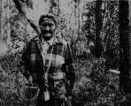 Bessie Barnabas of Salcha at age 94 picking berries, August 1974, Fairbanks.