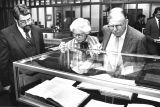 Dr. Marvin Falk, Curator of Rare Books, showing Mr. and Mrs. Elmer Rasmuson a display of rare...