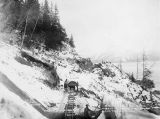 Widening the narrow cuts made by the Alaska Northern Ry [Railway] along Turnagain Arm.