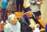 Peter John in cap and gown with Elsie.