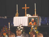 Altar with Chief Peter John portrait.