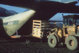 Forklift removing cargo from Herc.