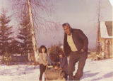 Peter John with children and sled.