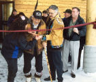 Cutting ribbon.
