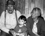 Peter John with wife and boy at potlatch.