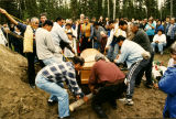 Lowering the coffin.