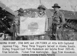 George Bishop, Stan Dayo and Jim Picken at Attu with captured Japanese flag.