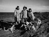 Point Barrow. Harold M. Snyder poses with a couple locals.