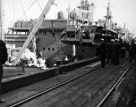 Detachment 1058. Loading ships at Tacoma for Point Barrow trip.