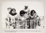 Eskimo school children at Wales with strands of ivory beads.