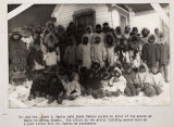 Mr. and Mrs. Clark M. Garber with their Eskimo pupils.