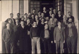 Male students and professors on the steps of the Main building in 1932-33.