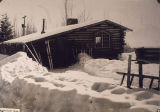 Log cabin built by Dr. and Mrs. F. G. Rainey, and later occupied by Dr. Ivar Skarland, was a...