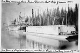700 tons moving down Tanana River on last trip of season, 1935. 300 tons of freight on steamer,...