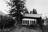 Backyard of nice log house. Fairbanks, 8/30/44.