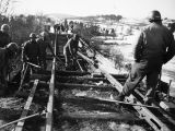 95th Engineers repairing railroad track near Ft. St. John.