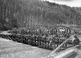 Dedication of Sikanni Chief River bridge. Alcan, 1943. 95th builders.