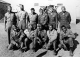 Fred Spencer and fellow soldiers pose for their picture after they completed basic training in...