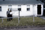 Man and woman standing in front of Tanacross Community Chapel.