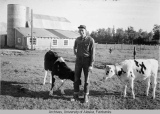 Thomas Moffitt on his dairy farm in the Matanuska Valley