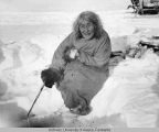 Woman ice fishing