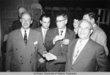 Harry Avakoff shaking hands with Adlai Stevenson
