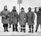 Group at the meeting of both ends of the Alaska Highway