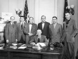 Governor B. Heintzleman signing bill.