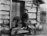 Boy on rockinghorse