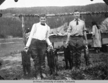 Missionaries with dog salmon.