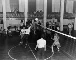 Volleyball in old gymnasium/museum, UAF