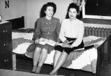 Margaret White from Stoney River, Alaska and Caroline McLain in dormitory room.