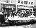 University of Alaska float in Fairbanks Winter Carnival Parade 1949. Caroline McLain in sled.
