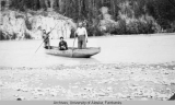 Poling boats across the Upper Tanana