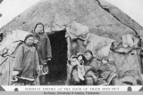 Siberian Eskimo at the door of their skin hut