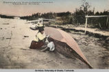 Repairing birch bark canoes, Tanana River.