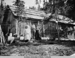 Children in front of a cabin.