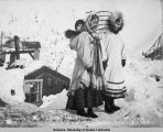 Eskimos just leaving [their] dwelling house.
