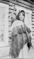Woman carrying a baby, at Tanana
