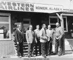 Group with Bud Hagberg in front of Western Airlines, Homer.