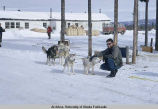 "Sled dogs. ""Old"" lodge in the background; it's where we stayed while in Northway."
