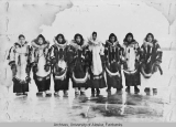 Group of eight women standing on the ice at Tanana.
