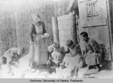 Holy Cross, ca. 1910, feeding mission poultry