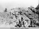 Holy Cross, ca. 1910, villagers on hill overlooking mission church