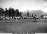 Players and spectators at a baseball game in Palmer, 1936.