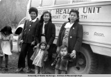 Patients and health personnel beside Mobile Health Unit, ca. late 1940's.