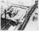 Aerial view of collapsed Anchorage building, 28 March 1964.