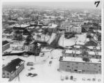 Aerial view of damaged buildings and streets in downtown Anchorage, 28 March 1964.