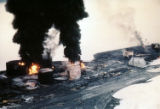 Oil tanks burning in town of Whittier.