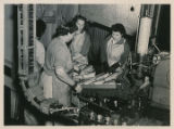 Women processing fish at Emard Cannery.